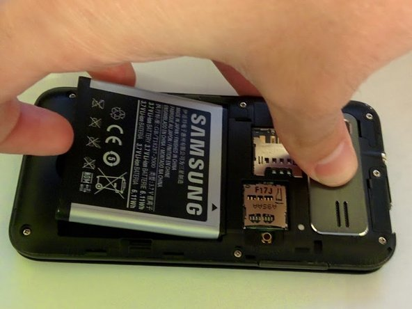 Remove battery with plastic opening tool or finger.