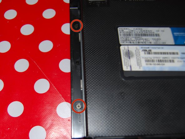 Image 2/2: Just below the DVD/CD drive, there are two little screws to remove.