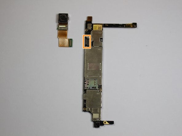Remove the ribbon cable and rear facing camera carefully.