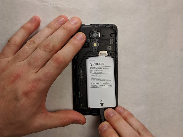 Remove the battery by popping it out of the phone by using your hands or the spudger to pry it up out of the case.