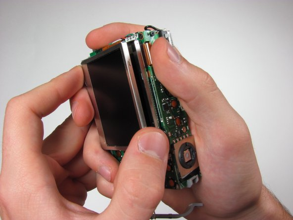 Image 2/3: Remove 3mm screw from LCD casing using #00 screwdriver.