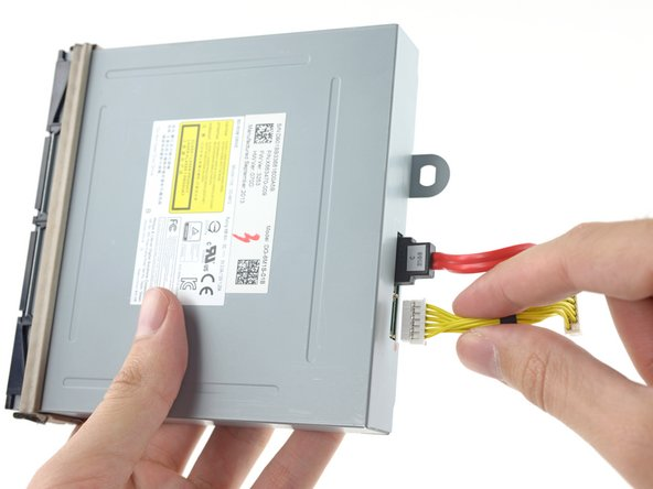 Remove the optical drive power and SATA data cables.