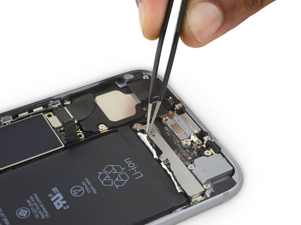 Optionally, you may wish to remove the Taptic Engine at this time. It's very easy to remove and will allow better access to the adhesive strips.