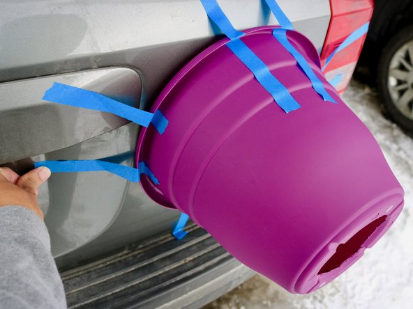 Place the bucket over the dent that needs to be fixed