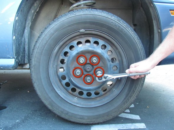 Image 1/2: Torque the metal lug nuts to 100 ft-lbs when putting the wheels back on the car.