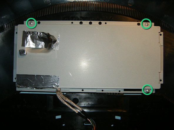 Image 3/3: Remove the bottom sheet metal, this will leave the cage for the electronics. remove the three Phillips screws.