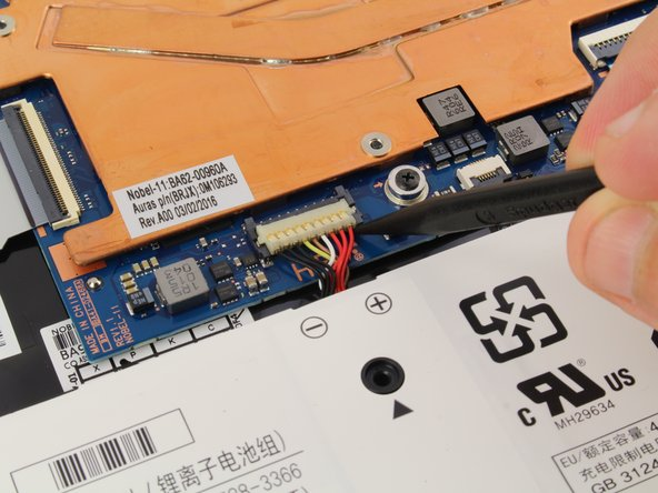 Use a spudger to gently pry the power cable cord upwards from the motherboard.