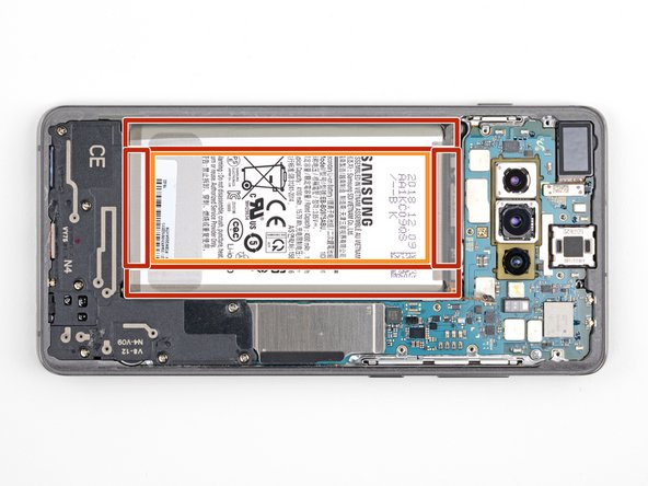 The battery is heavily glued in place. Note the marked areas under the battery: