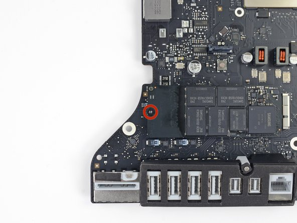 Remove the single 5.3 mm T9 screw securing the SSD to the logic board.