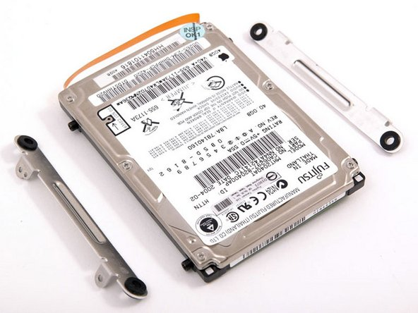Remove the hard drive brackets from the left and right sides of the hard drive.