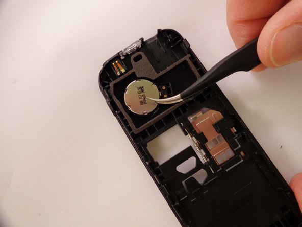 Insert tweezers into the small crevices of the backside of the speaker, and lift upwards.