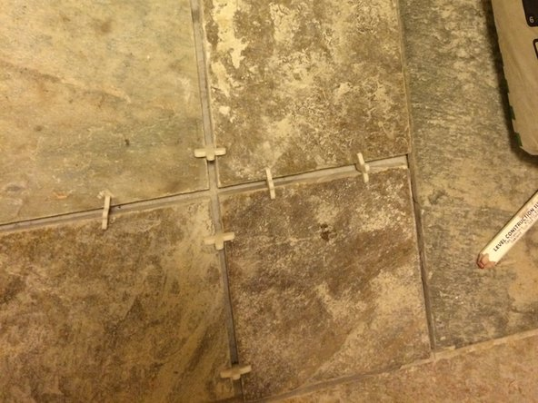 Continue spreading mortar and tile in the same method as described in steps three through seven until the desired area has been tiled.
