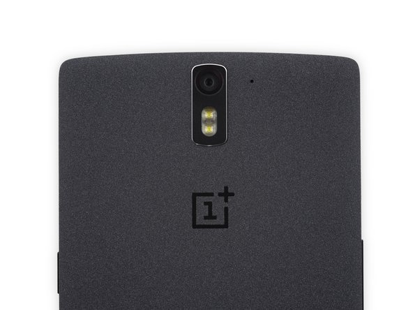 Image 1/3: Designed by OnePlus and assembled in China, the OnePlus One is identified as model number A0001.