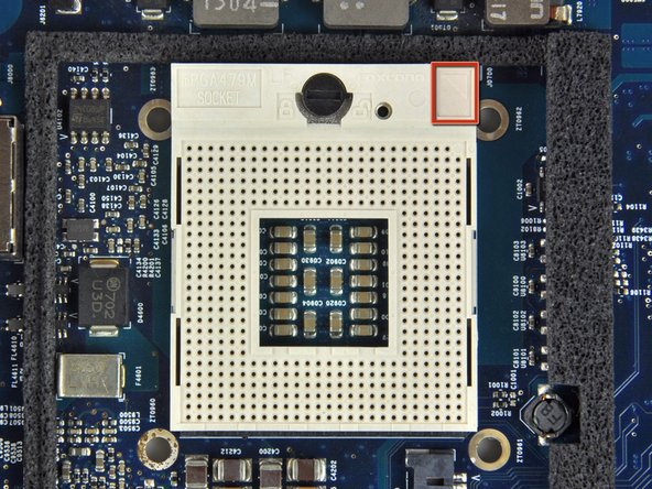 Image 1/3: To aid in installation, processors and sockets have a small alignment arrow (shown in red) so the chip is installed in the correct orientation.