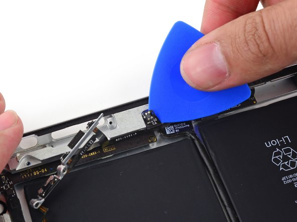 Use the point of an opening pick to gently peel the Smart Cover sleep/wake sensor up off the rear case.