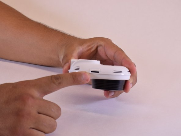 On left hand side of your SmartCam there is a slot for you to press in order to release your old microSD card.