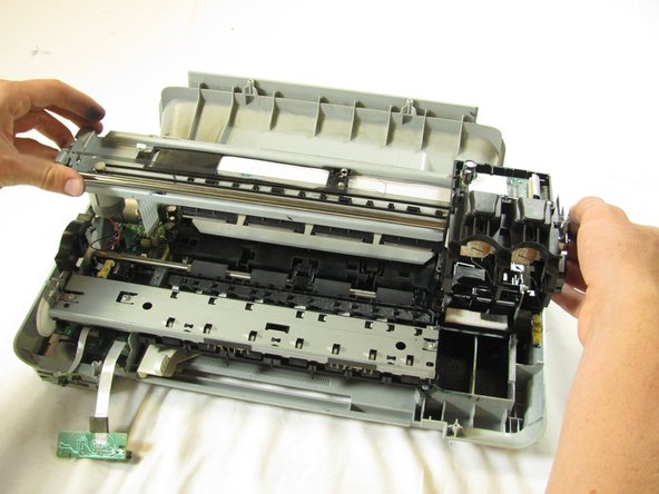 Using both hands, carefully lift the  ink cartridge track off of the main body of the printer.