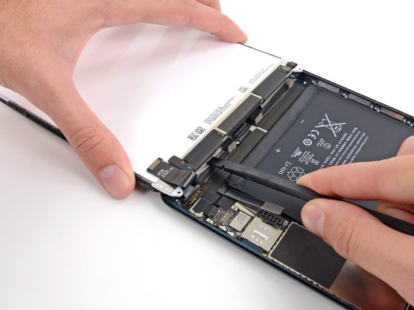 While holding the LCD with one hand, insert the flat end of a spudger between the LCD and tape on the iPad's right side.