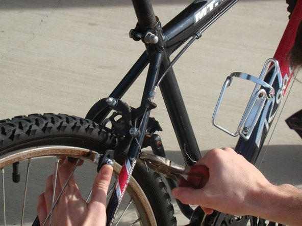 Pull the brake cable until proper tension is acquired and the cable shows resistance.