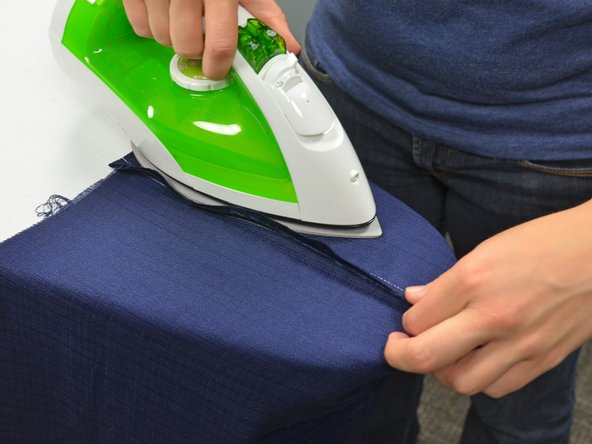 Using the same technique as above, work in one direction over the seam, ironing it flat.