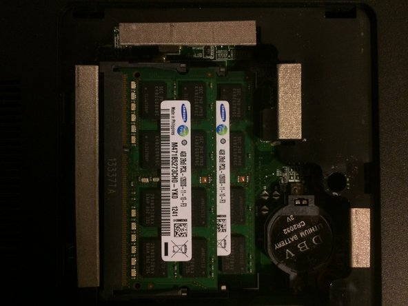 Gently move the 2 notches on the ends of each ram stick and the stick should pop out at a 30 degree angle