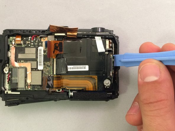 Image 1/2: To avoid damage, only pry against the metal covers when removing the lens box.