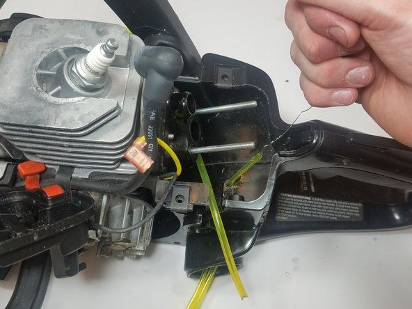 Attach the wire to the cut end of the thinner diameter fuel line as in the previous step