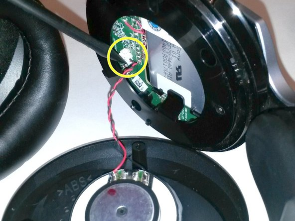 Using tweezers, gently pry the red and black speaker wires from the attached socket.