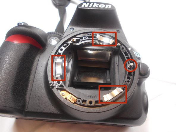 Image 1/2: The locating pin on the right of the camera will help place the mounting ring properly.