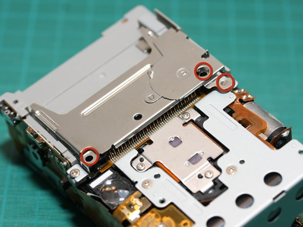 Remove the 3 screws holding the CF card slot.