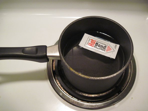 Boil water in a flat bottomed pan.