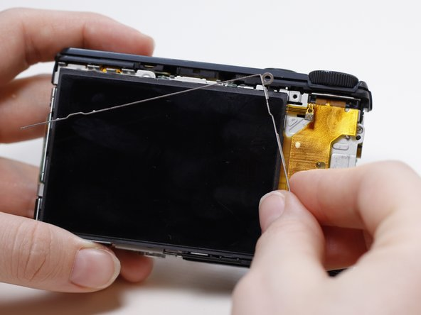 Remove the thin metal frame that runs along the top of the LCD screen.