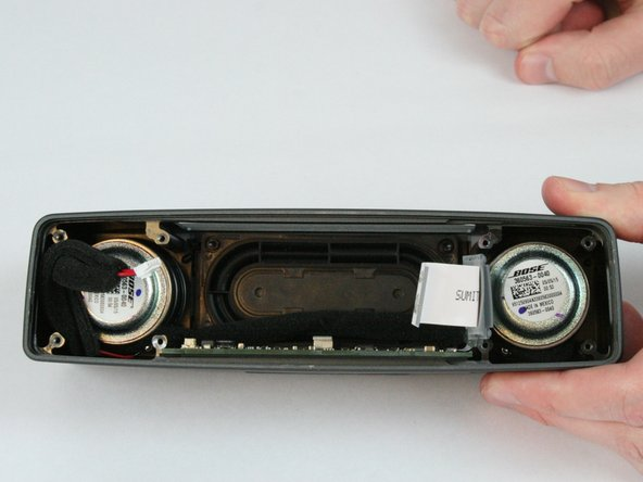 Image 2/2: There is a non latched connector connecting the side board to button board. Be careful to not damage this connector during the removal process.