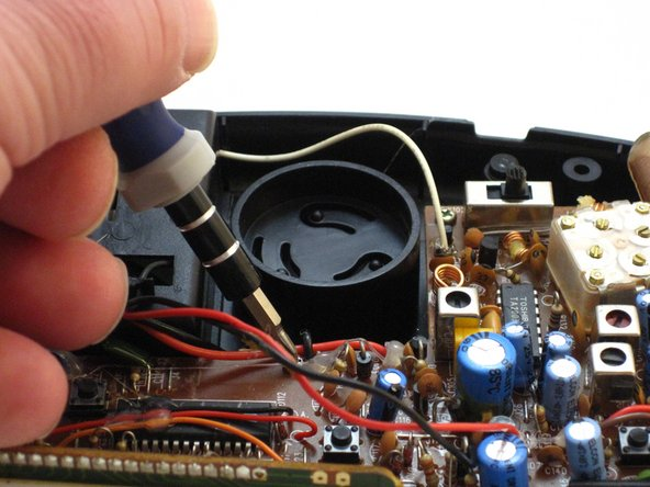 Image 2/2: Using a Phillips #0 Screwdriver, unscrew the two 6 mm screws from the PCB.