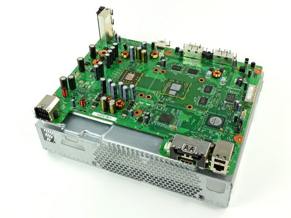 After heating the back of the motherboard for one minute, flip the motherboard over and lay it on the chassis as shown.