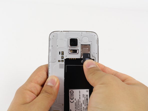 For reassembly, gently slide in the microSD card until it stops.