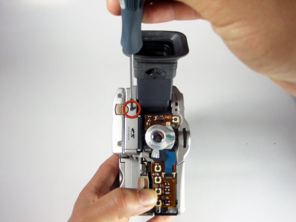 Remove the 4mm #00 Phillips screw located to the right of the LCD release switch.