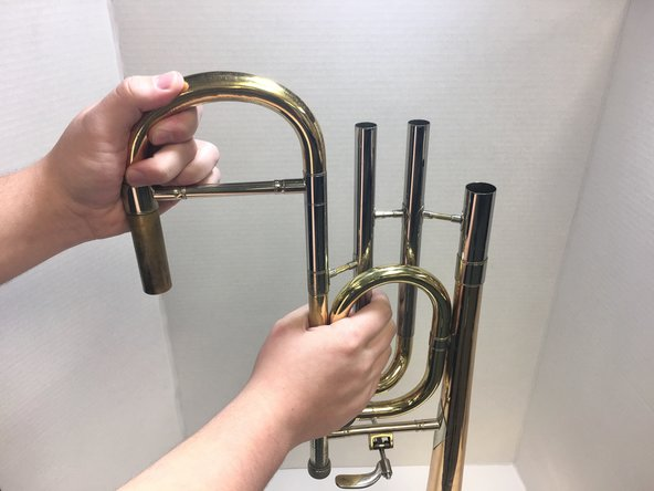 If the slides are parallel, skip to step six. If not, attach each individual slide to the trombone and push/pull in the direction in which it would be parallel.