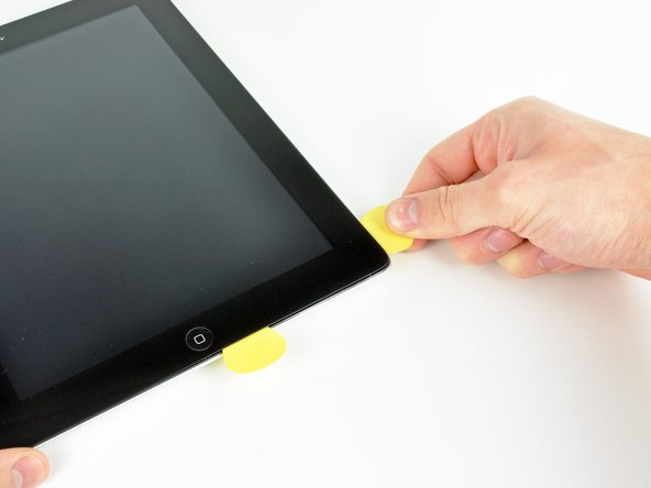 Use your heat gun to heat the edge of the front panel near the bottom right corner of the iPad.