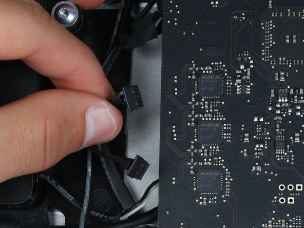 Carefully pull on the connector to release it from its socket in the logic board.