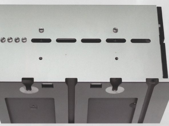 Image 1/1: Note: There are 4 screws provided by Apple already on the back side of the drive carrier. Remove and use them to fasten the drive to the carrier.