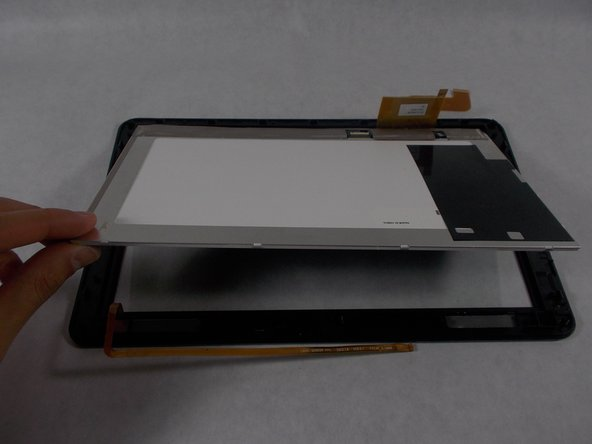 The screen is now free. Lift the screen out of the glass panel. The screen can now be replaced.