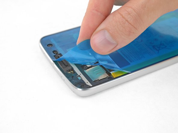Peel off and discard the plastic liner, exposing the display adhesive.