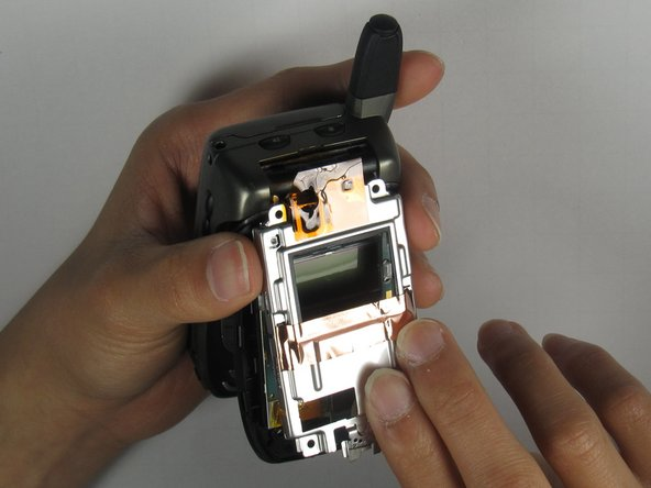 Place your thumb underneath the protective metal covering to remove it from the phone.