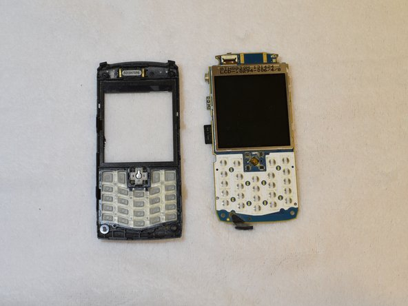 The front panel is now ready to be removed from the rest of the phone. To do this, just pry the front part (with the keyboard and screen) away from the logic board of the phone with your fingers.
