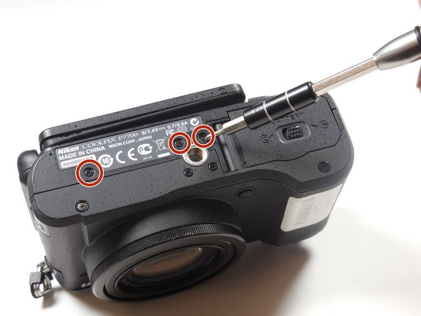 Remove the 4.3 mm black screws on the bottom of the camera using the Phillips #00 screwdriver.