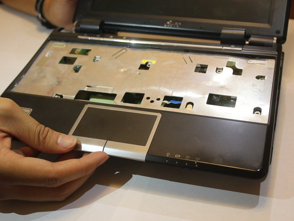 Remove the touchpad chassis to fully separate it from the device