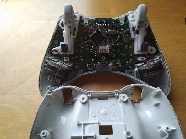 Remove the rear half of the controller by pulling perpendicular to the front half.