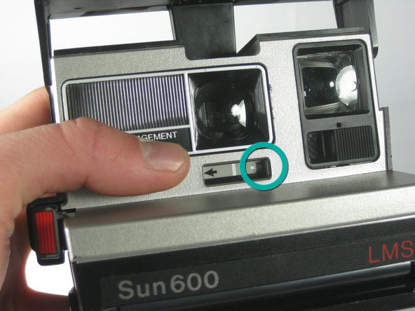 Image 2/2: Slide light switch towards the white arrow on the right to increase exposure.