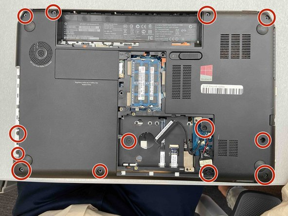 Remove the 13 screws on the bottom of the laptop that secure the top cover using a Phillips #1 screwdriver.